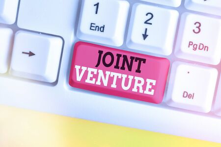 Text sign showing Joint Venture. Business photo showcasing business partnership invested jointly by two or more companies