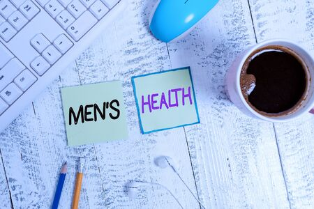 Foto de Handwriting text writing Men S Health. Conceptual photo men s is state of complete physical, mental, and social wellbeing Writing equipment and computer stuff plus drinks placed above wooden table - Imagen libre de derechos
