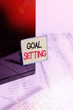 Handwriting text Goal Setting. Conceptual photo dream big motivational advice or reminder to take action Notation paper taped to black computer monitor screen near white keyboard