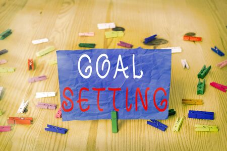 Writing note showing Goal Setting. Business concept for dream big motivational advice or reminder to take action