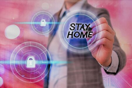 Text sign showing Stay Home. Business photo showcasing not go out for an activity and stay inside the house or home Graphics padlock for web data information security application system