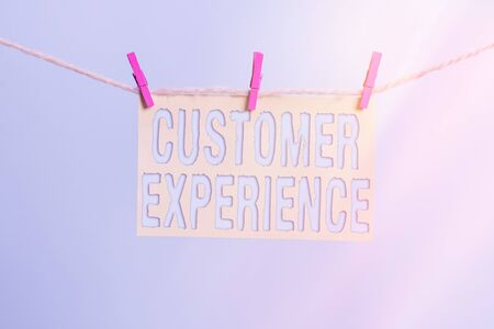 Photo for Word writing text Customer Experience. Business photo showcasing phrase to describe relationship user has with business Clothesline clothespin rectangle shaped paper reminder white wood desk - Royalty Free Image