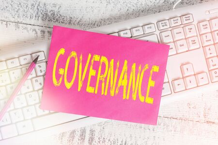 Handwriting text writing Governance. Conceptual photo exercised in handling an economic situation in a nation White keyboard office supplies empty rectangle shaped paper reminder wood