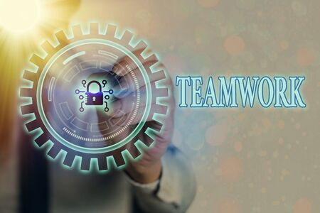 Writing note showing Teamwork. Business concept for the group s is collaborative effort to accomplish a common goal Graphics padlock for web data information security application system