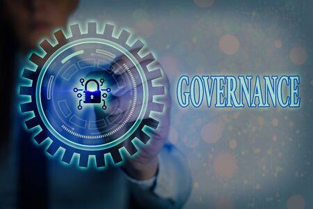 Writing note showing Governance. Business concept for exercised in handling an economic situation in a nation Graphics padlock for web data information security application system