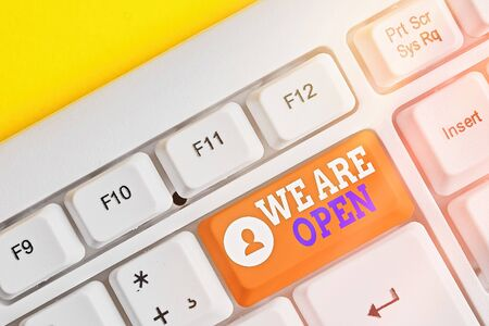 Photo for Conceptual hand writing showing We Are Open. Concept meaning no enclosing or confining barrier, accessible on all sides White pc keyboard with empty note paper above white key copy space - Royalty Free Image
