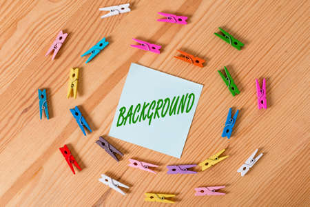 Writing note showing Background. Business concept for conditions that form the setting which something is experienced Colored clothespin papers empty reminder wooden floor background office