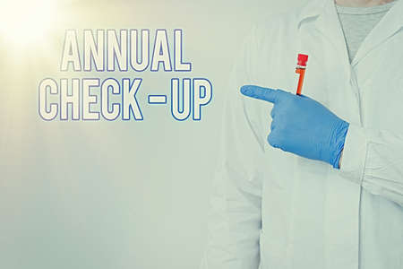 Photo pour Writing note showing Annual Checkup. Business concept for yearly reproductive health visit with a health care provider Laboratory Blood Test Sample Shown For Medical Diagnostic - image libre de droit