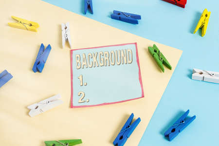 Word writing text Background. Business photo showcasing conditions that form the setting which something is experienced Colored clothespin paper empty reminder yellow blue floor background office