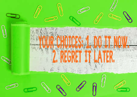 Photo for Writing note showing Your Choices 1 Do It Now 2 Regret It Later. Business concept for Think first before deciding Rolled ripped torn cardboard above a wooden classic table - Royalty Free Image