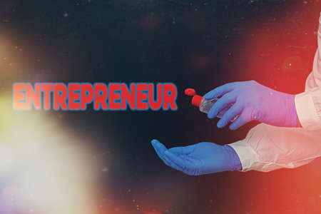 Conceptual hand writing showing Entrepreneur. Concept meaning one who organizes and assumes the risks of a business Displaying Sticker Paper Accessories With Medical Gloves On