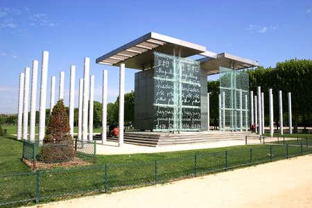 PARIS - May 7: Mur de la Paix in Paris, France on May 7, 2009. Mur de la Paix was erected in 2000 on Champ de Mars to symbolize passage into 3rd millennium (word PEACE is written in 32 languages).