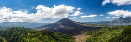 Batur volcano and Agung mountain panoramic view with blue sky from Kintamani, Bali, Indonesia