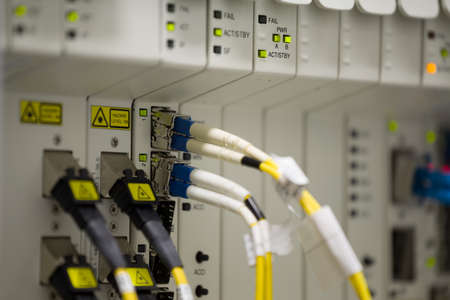 service provider data center with media converters and optical cables
