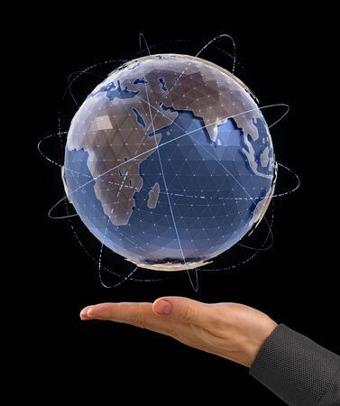World Globe - Infographic Presentation. 'Holographic' 3D model of a globe above the facing up palm of a man's hand on black background.