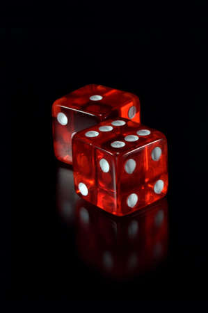 Two dices on a black background. Focus on a first dice.