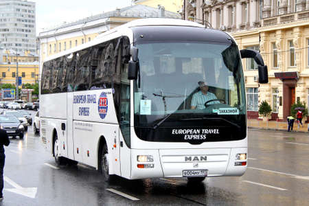 MOSCOW, RUSSIA - JUNE 3, 2012: White MAN R07 Lions Coach interurban coach at the city street.