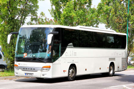 VENICE, ITALY - JULY 30, 2014: White interurban coach Setra S415GT-HD at the city street near the touristic bus station.