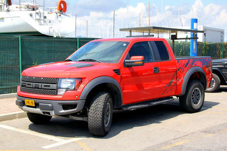 SAINT-TROPEZ, FRANCE - AUGUST 3, 2014: Red american pickup car Ford F150 Raptor at the city street.