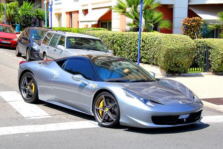 MENTON, FRANCE - AUGUST 2, 2014: Silver italian sports car Ferrari 458 Italia at the street of French Riviera.