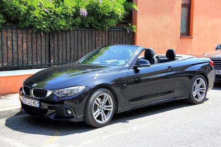 SAINT-TROPEZ, FRANCE - AUGUST 3, 2014: Black convertible sports car BMW F33 4-series at the city street.