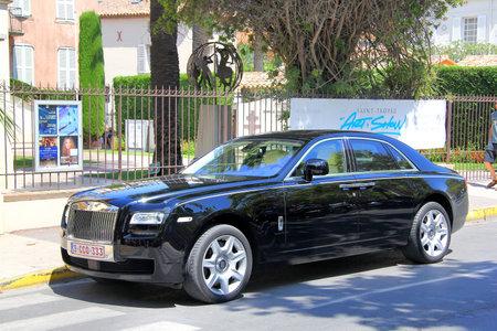 SAINT-TROPEZ, FRANCE - AUGUST 3, 2014: Black british premium class sedan Rolls-Royce Ghost at the city street.