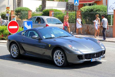SAINT-TROPEZ, FRANCE - AUGUST 3, 2014: Silver sports car Ferrari 599 GTB Fiorano at the city street.