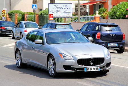SAINT-TROPEZ, FRANCE - AUGUST 3, 2014: Silver luxury sedan Maserati Quattroporte at the city street.