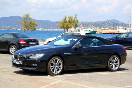 SAINT-TROPEZ, FRANCE - AUGUST 3, 2014: Black convertible sports car BMW F12 6-series at the city street.