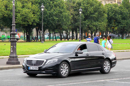 PARIS, FRANCE - AUGUST 8, 2014: Black luxury car Mercedes-Benz W222 S-class at the city street.