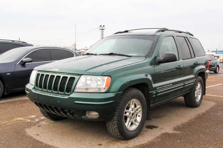 UFA, RUSSIA - APRIL 19, 2012: Motor car Jeep Grand Cherokee at the used cars trade center.