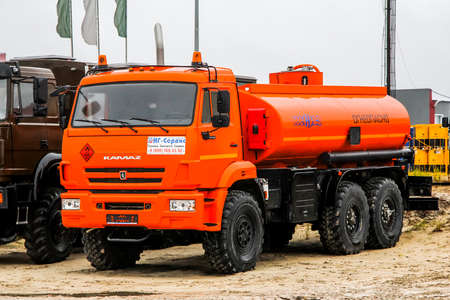 NOVYY URENGOY, RUSSIA - SEPTEMBER 19, 2015: Brand new cistern truck KAMAZ 43118 at the city street.