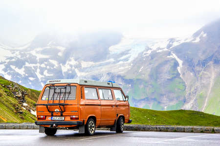 Photo for TYROL, AUSTRIA - JULY 29, 2014: Blue classic van Volkswagen Caravelle at the parking near the high Alpine mountain road. - Royalty Free Image