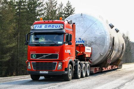 Foto de Chelyabinsk region, Russia - May 9, 2011: Red semi-trailer truck Volvo FH16.660 at the interurban road. - Imagen libre de derechos
