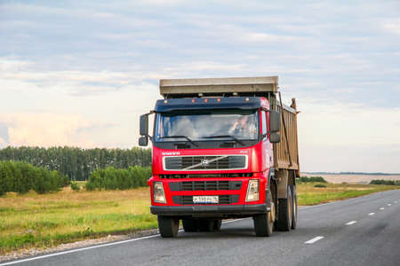Tatarstan, Russia - August 27, 2011: Red dump truck Volvo FM12 at the interurban road.
