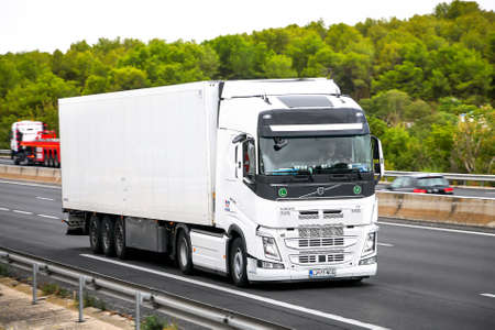 Photo for Occitanie, France - September 10, 2019: White semi-trailer truck Volvo FH12.500 at the interurban road. - Royalty Free Image