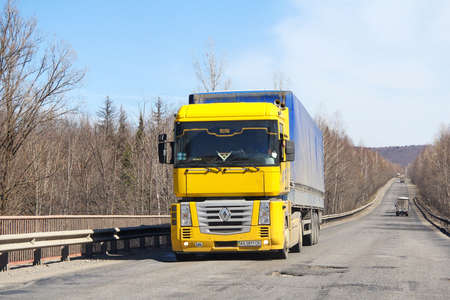 Photo for Chelyabinsk Region, Russia - April 14, 2012: Bright yellow truck Renault Magnum at the interurban road. - Royalty Free Image
