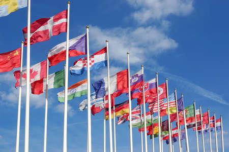 Foto de World Flags Blowing In The Wind On The Cloudy Sky Background - Imagen libre de derechos