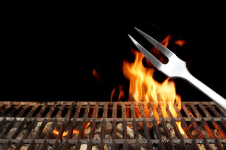 Empty Flaming Charcoal BBQ Grill With Bright Flames On The Isolated Black Background. Weekend Barbecue Party  Or Picnic Concept.