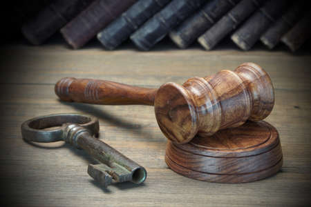 Photo pour Judges Or Auctioneer Gavel, Retro Door Key, Old Law Book On The Wood Table. Concept For Trial, Bankruptcy, Tax, Mortgage,  Auction Bidding, Foreclosure Or Inherit Real Estate - image libre de droit