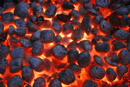 Photo for BBQ Grill Pit With Glowing And Flaming Hot Charcoal Briquettes, Food Background Or Texture, Close-Up, Top View - Royalty Free Image