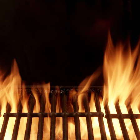 Photo pour Barbecue Fire Grill Isolated On Black Background. BBQ Flaming Grill Background Isolated. Hot Barbeque Charcoal Cast Iron Grill With Bright Flames. - image libre de droit