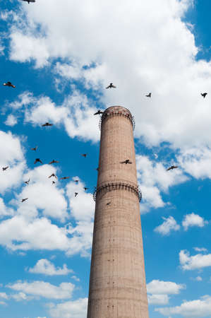 Industrial chimney with blue sky
