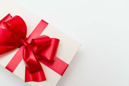 Photo for Top view Cristmas white gift box present red bow white studio background. - Royalty Free Image