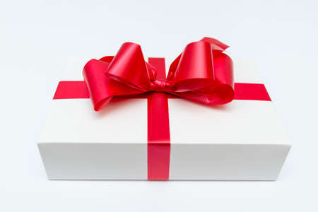 Photo for Cristmas white gift box present red bow white studio background. - Royalty Free Image