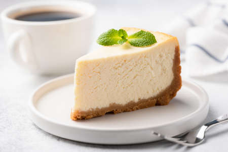 Photo pour Tasty Plain New York Cheesecake On White Plate Decorated With Mint Leaf. Closeup View - image libre de droit