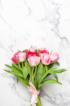 Photo for Bouquet of pink tulips on marble background with copy space for text or design - Royalty Free Image