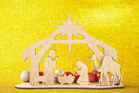 Photo for Christmas Nativity Scene of baby Jesus in the manger with Mary and Joseph in silhouette surrounded by the animals and wise men with the city of Bethlehem in the distance with - Royalty Free Image