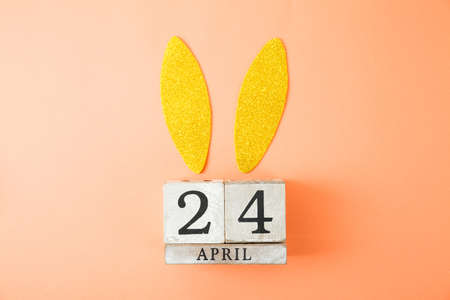Photo for Easter background. Bunny ears and calendar on color background - Royalty Free Image