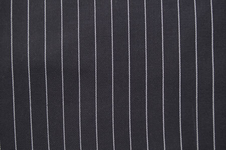 Black and white pinstripe suit detail up close